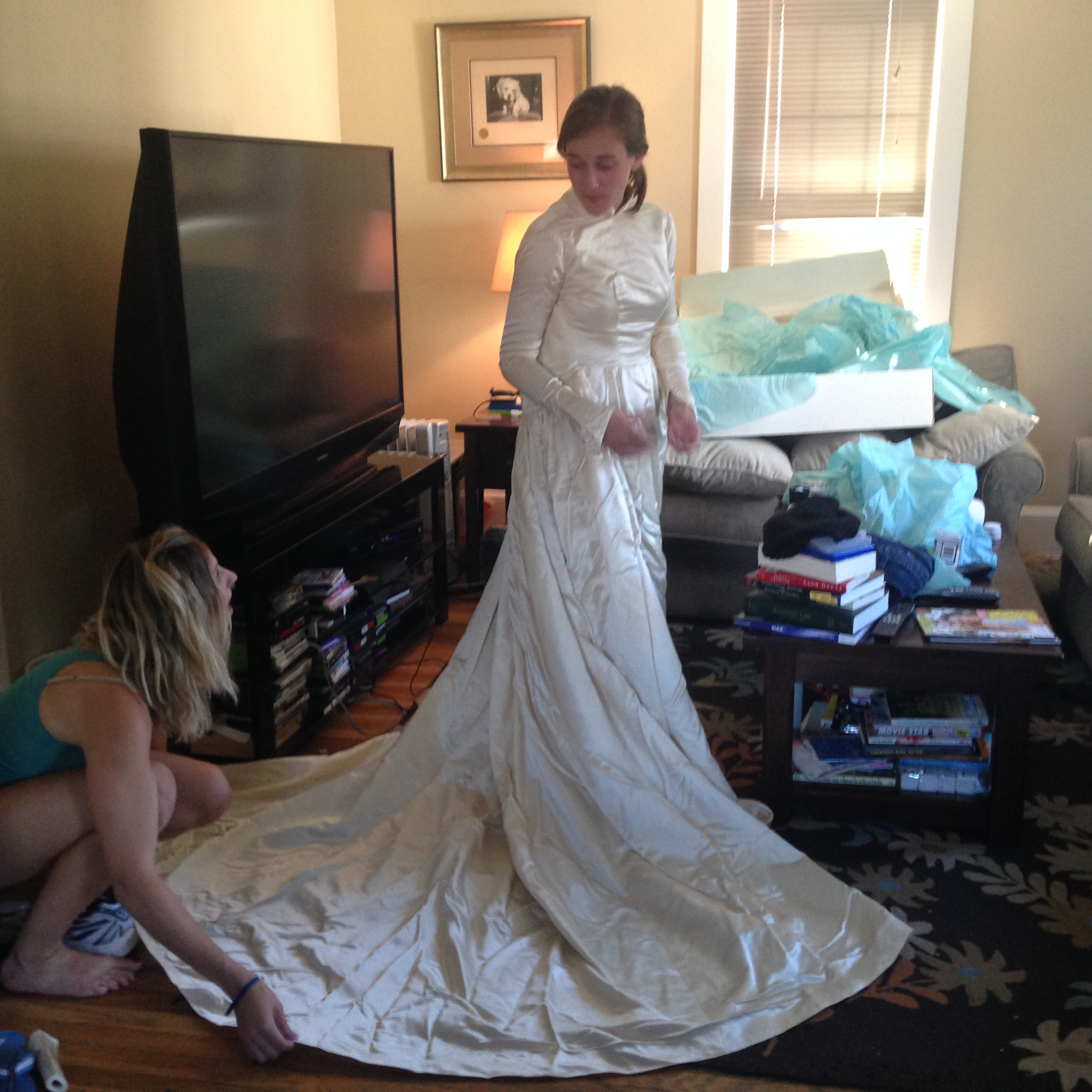 Abby tries on the gown