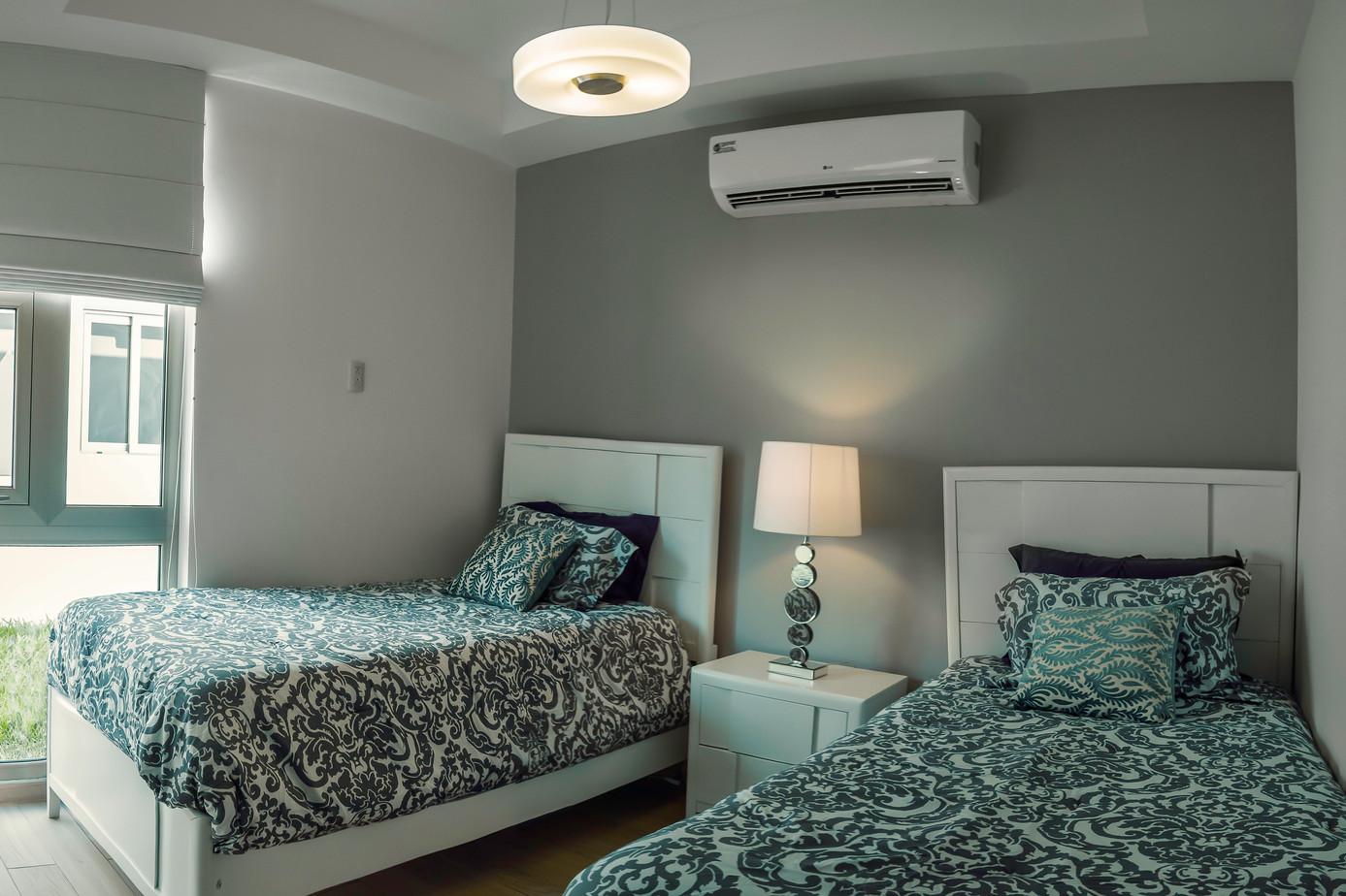 08+dormitorio+dos+camas.jpeg