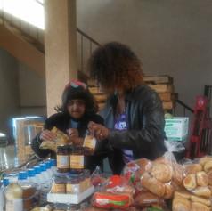 Dr. Million serving at the Food Distribution