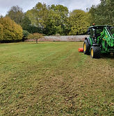 grass cutting paddock with tractor