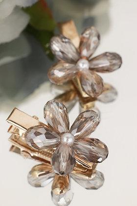 Pareja de pincitas doradas con flor cristal topo