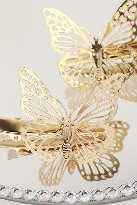 Pareja de pinzas doradas con mariposa