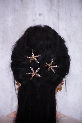 Trío de estrellas marrones