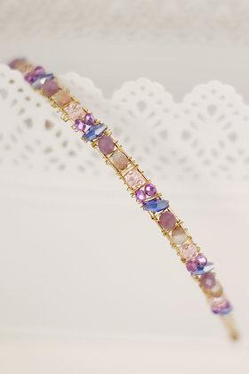 Diadema Brillos dorada lilas