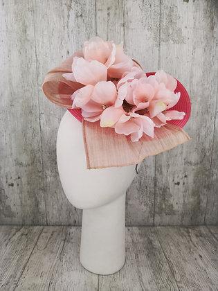 Disco doblado, lazada y flores coral