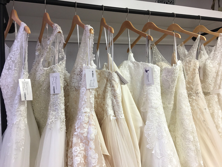 Some of our many gowns in store! A lines, ballgowns, sheaths, and fit and flares. Find the perfect lace, beading, applique, and rouching. Fit any theme and any personality!
