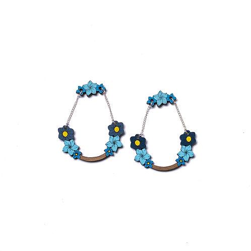 Boucles d'oreilles en bois fleurs bleues et chaine argent
