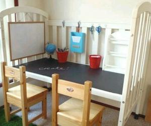 Convert an old crib into a kid desk.