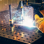 man-welds-at-the-factory-working-in-meta