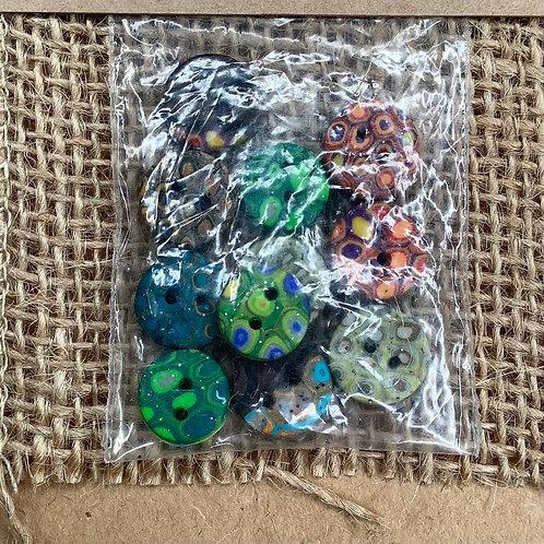 11 buttons Approx 11mm diameter