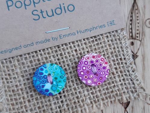 2 buttons Approx 15mm diameter