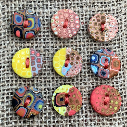 9 buttons Approx 15mm diameter