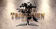 Seven Tribesmen logo on wall inside tasting room