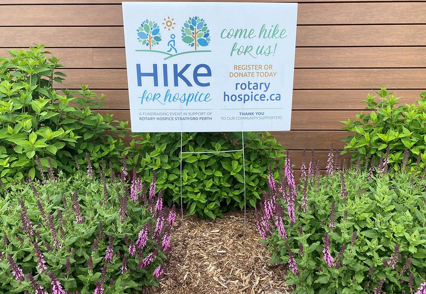 Hike for Hospice Sign in garden.jpg