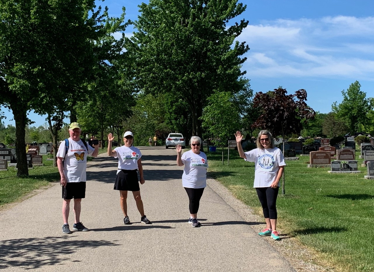 Board Director Dennis Young and his team out hiking in the cemetery