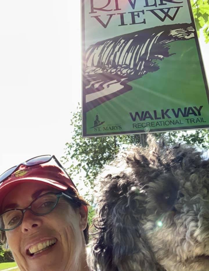 Hospice volunteer Julie hiking with her pup!