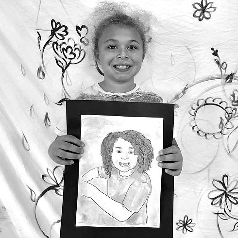 Girl-holding-her-drawing_1000sq_edited.j