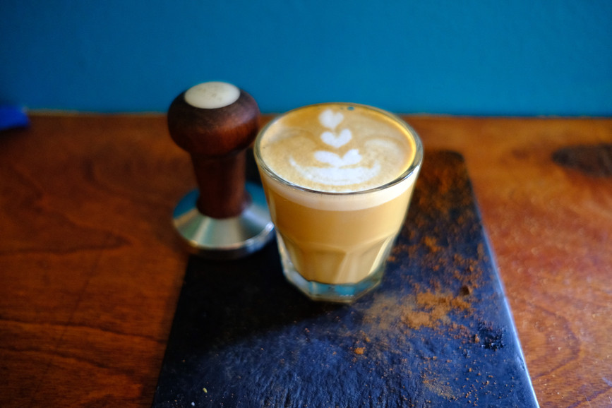 A cortado with latte art