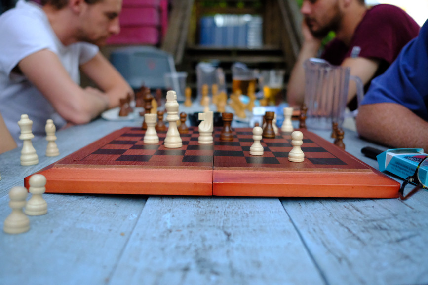 A competitive game of chess plays out in our courtyard