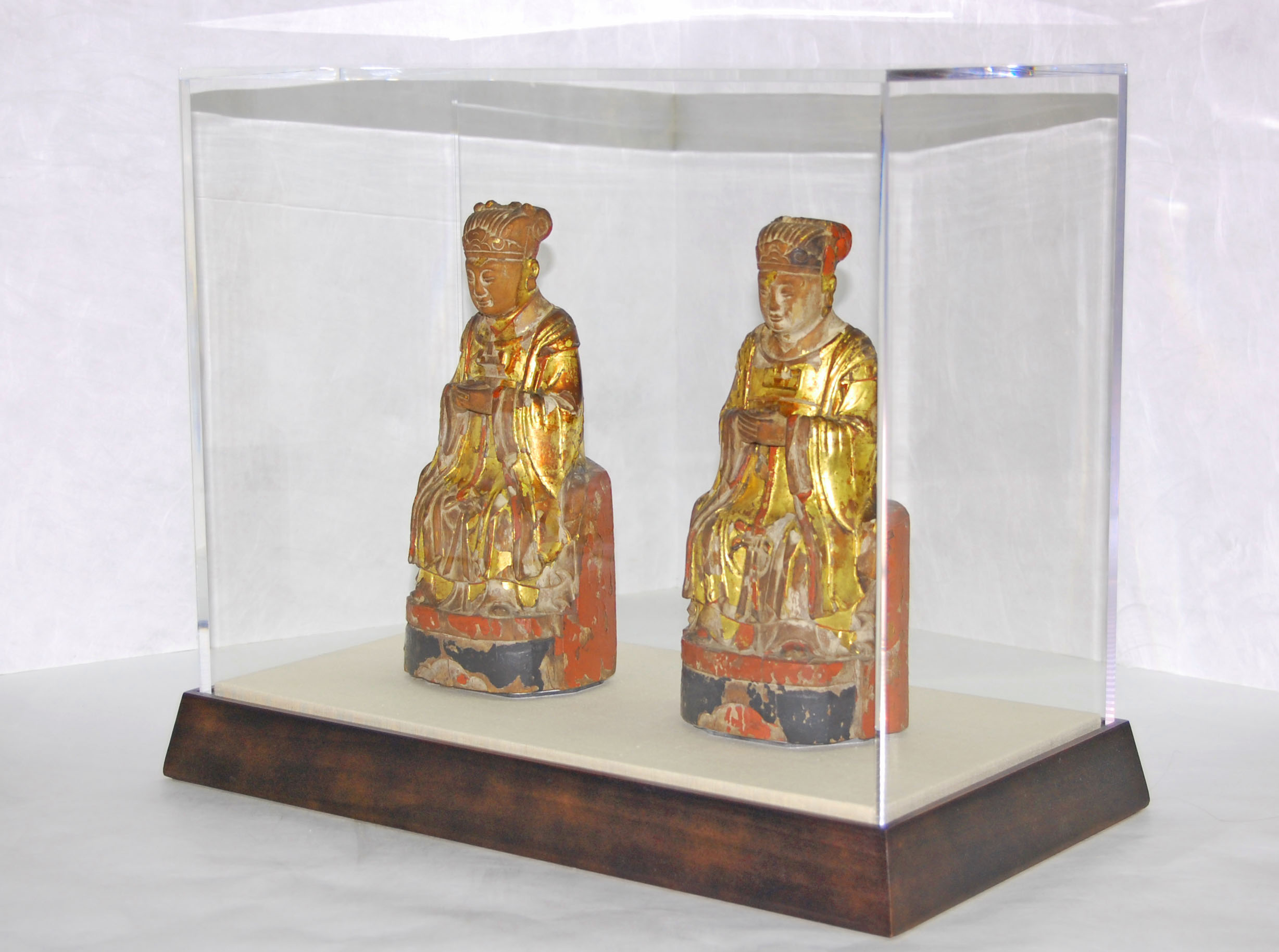 Display case for Asian sculptures