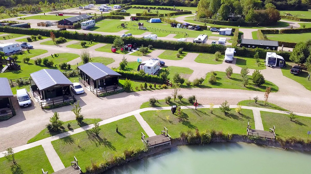 Lodges, small fishing lakes and hard standing pitches at Henlow Bridge Lakes.