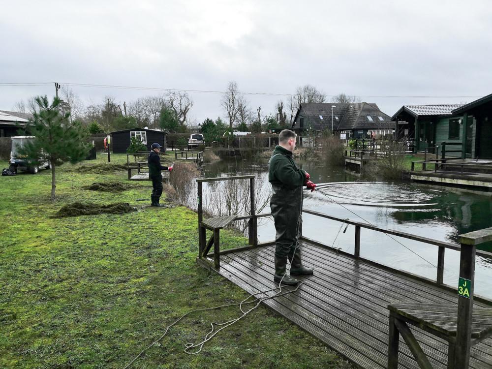 dredging pond weed