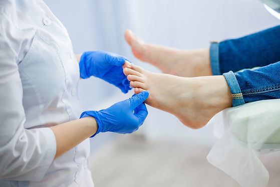 Podiatry doctor examines the foot.jpg