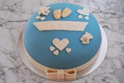 Blå tårta m. fötter och hjärtan