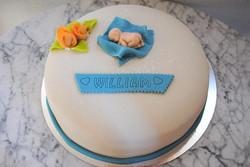 Babytårta bebis och blå filt