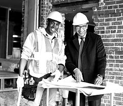 Two engineers look over a set of blueprints and consider using Top Notch to hire their workers.