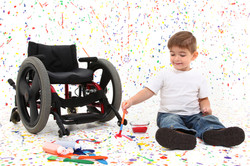child painting floor