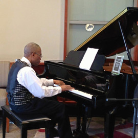 Dr. Darely (1964~2017) was one of the most incredible people I've ever met in my life. He was a passionate musician and a lover of  Chopin's music. I am extremely grateful that Dr. Darley became my dear friend and mentor during 5 years of teaching him.   Dr. Darley was as an intensive pediatric doctor in South Bend and a pediatric burn specialist in Baton Rouge, Louisiana. This photo was taken when he was giving a full recital at the Baton Rouge Medical Center.   I truly teasure all the wonderful memories of him.
