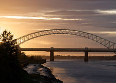 Sunset Behind Runcorn Bridge by Kurt Far