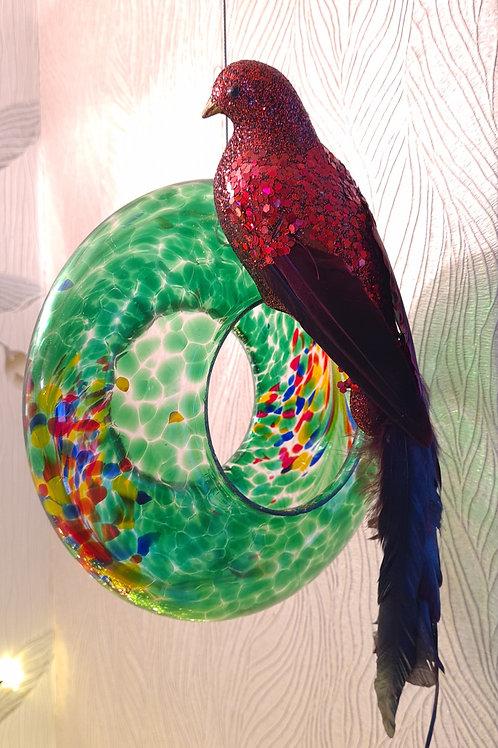 Hanging green glass bird feeder