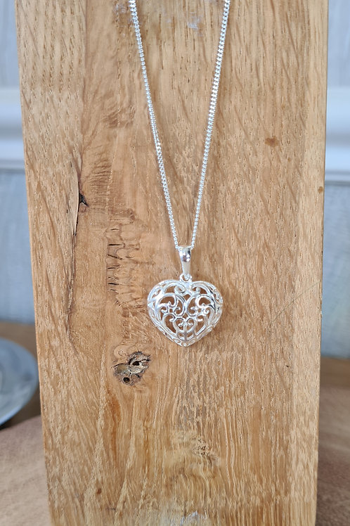 Filigree sterling silver heart necklace.