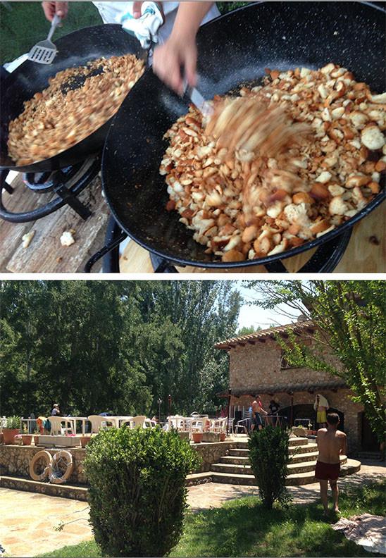 Gente cocinando en dos sartenes al aire libre, fogonos de gas, removiendo la comida. Gente en una cada rural, al aire libre, en la piscina.