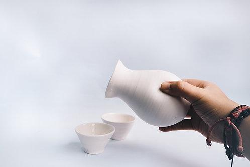 porcelain hand thrown sake flask w 2 cups
