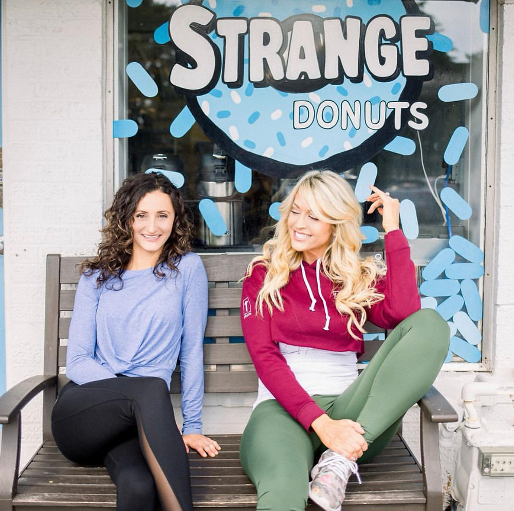 Mindy Musselman and Emily Frisella outside Jason Bockman's Strange Donuts shop in Kirkwood, Missouri