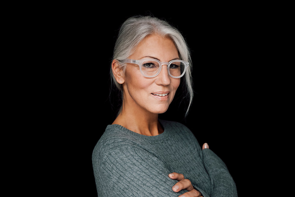 Smiling confident business women portrait with white hair and glasses
