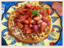 Kidfunideas.com Strawberry bacon waffles.  Delicious fluffy waffles with crispy bacon baked right inside and topped with fresh strawberries.  Perfect for Mother's day