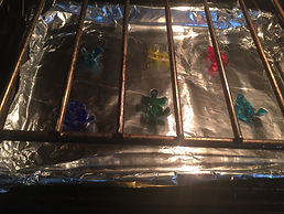Kidfunideas.com Autism awareness bracelet craft pictyure of the puzzle pieces in the oven