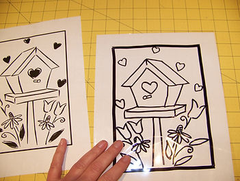 Kidfunideas.com Valentine's Stained glass craft picture of inserting the pattern into the sheet protector