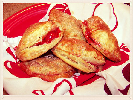 Kidfunideas.com Cherry Hand pies.  Perfect beginner dessert for kids to make.  We filled flaky puff pastry with cherry pie filling for these tasty hand pies