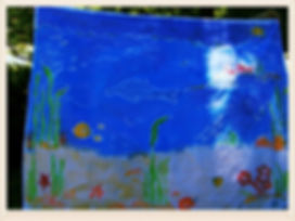 Kidfunideas.com Batik style craft for kids.  Have fun making a beautiful batik style picnic cloth or wall hanging.  Part of our fun craft challenge