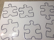Kidfunideas.com Autism awareness bracelet craft picture of the puzzle pieces