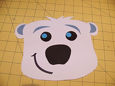 Kidfunideas.com Polar bear paper bag puppet picture of assembling the face