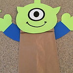Kidfnideas.com Alien paper bag puppet picture of what the arms look like on the puppet