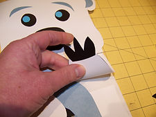 Kidfunideas.com polar bear paper bag puppet picture of attaching the hands
