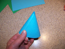 Kidfunideas.com astronaut to the moon space craft picture of forming the cone for the rocket