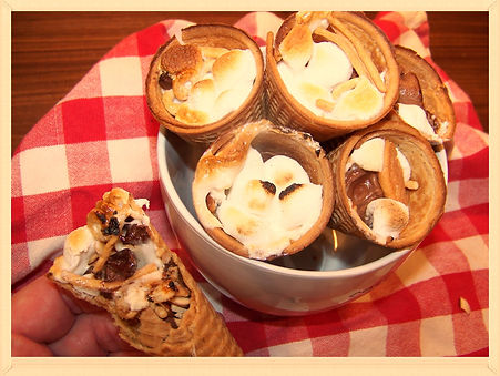 Kidfunideas.com Camping cones.  Yummy camping treats.  We packed these waffle cones with all kinds of treats wrapped them up and baked them in the oven.  Perfect for any sleepover or camping trip